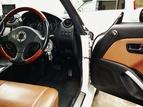 高音質に改造されたダイハツコペンの運転席の写真です。
